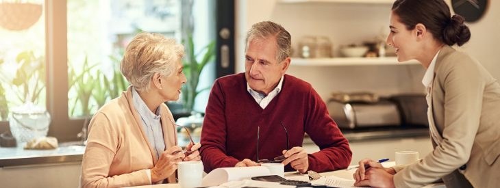 Couple nearing retirement speaks with an advisor about their retirement savings