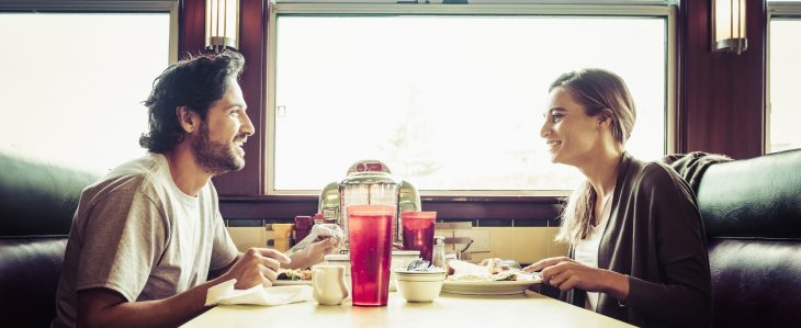 Couple eating breakfast at a diner