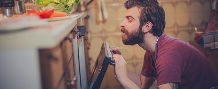 Man cooking dinner at home to save money